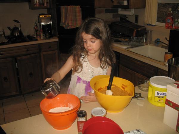 Juliet pouring flour