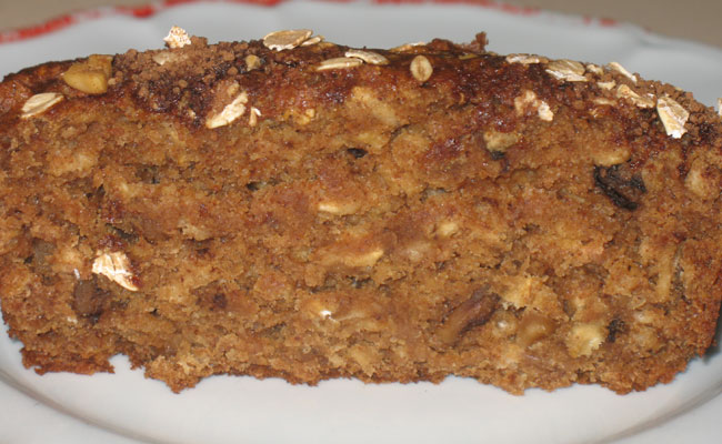 slice of oatmeal tea bread with walnuts
