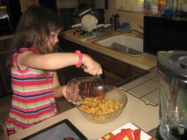 Juliet pouring Cheerios