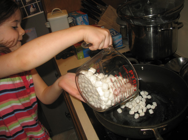 Juliet pouring marshmallows into pan