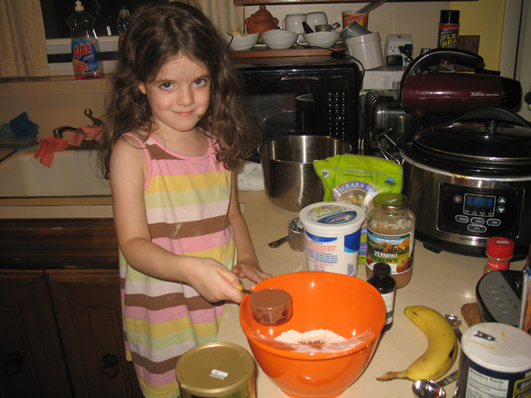 Juliet adding cocoa powder