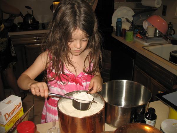 Juliet measuring flour