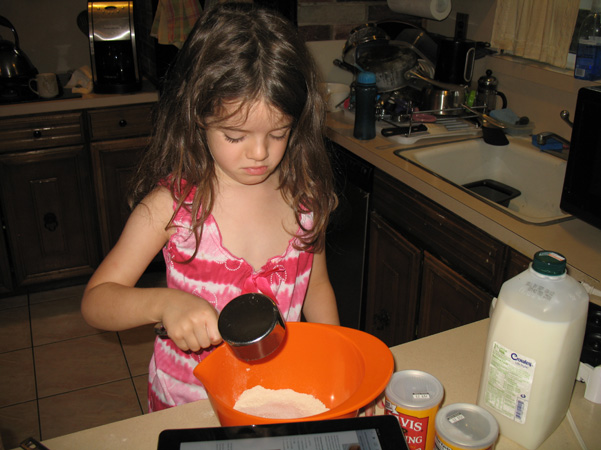 Juliet pouring flour into bowl