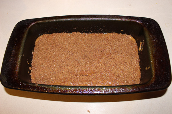 pumpkin espresso bread batter in pan with topping