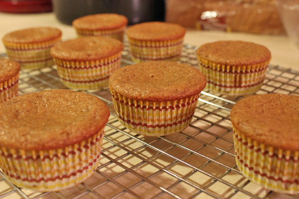 chai spiced vanilla bean muffins on rack
