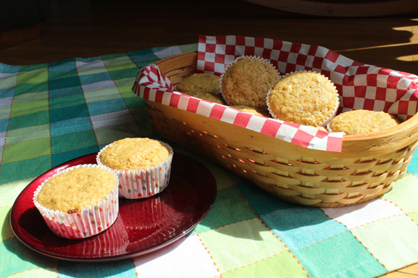 orange oat muffins in basket