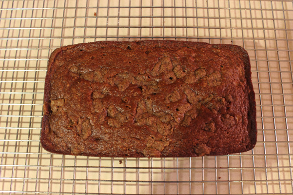 one banana banana bread baked and cooling on rack
