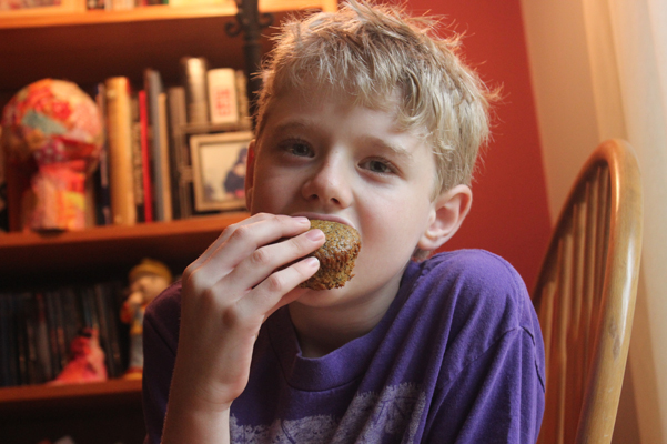 Nathaniel eating muffin