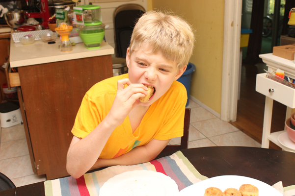 Nathaniel eating donuts