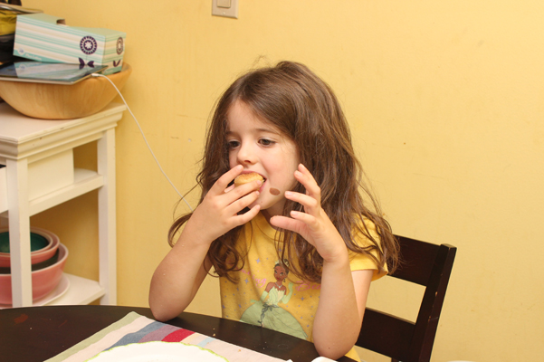 Juliet eating donuts