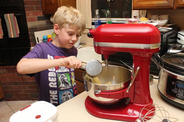 Nathaniel pouring sugar