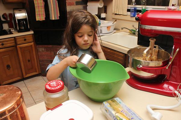 Juliet adding flour