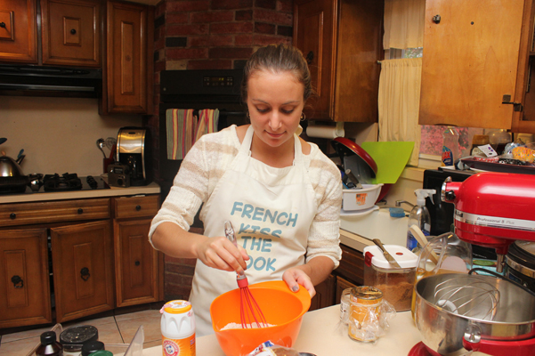 Tracy whisking dry ingredients