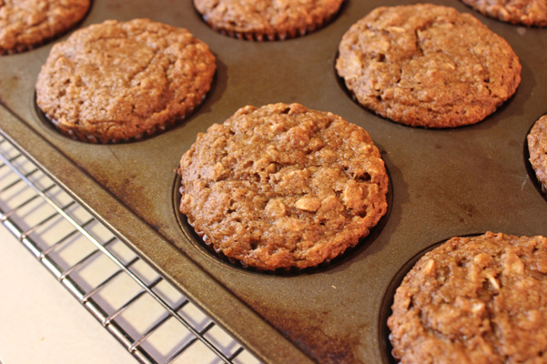 healthy banana oat muffins, baked, in tin
