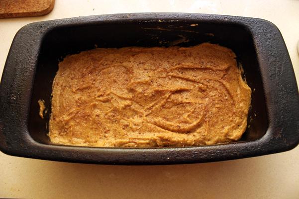 batter in pan with cinnamon-sugar